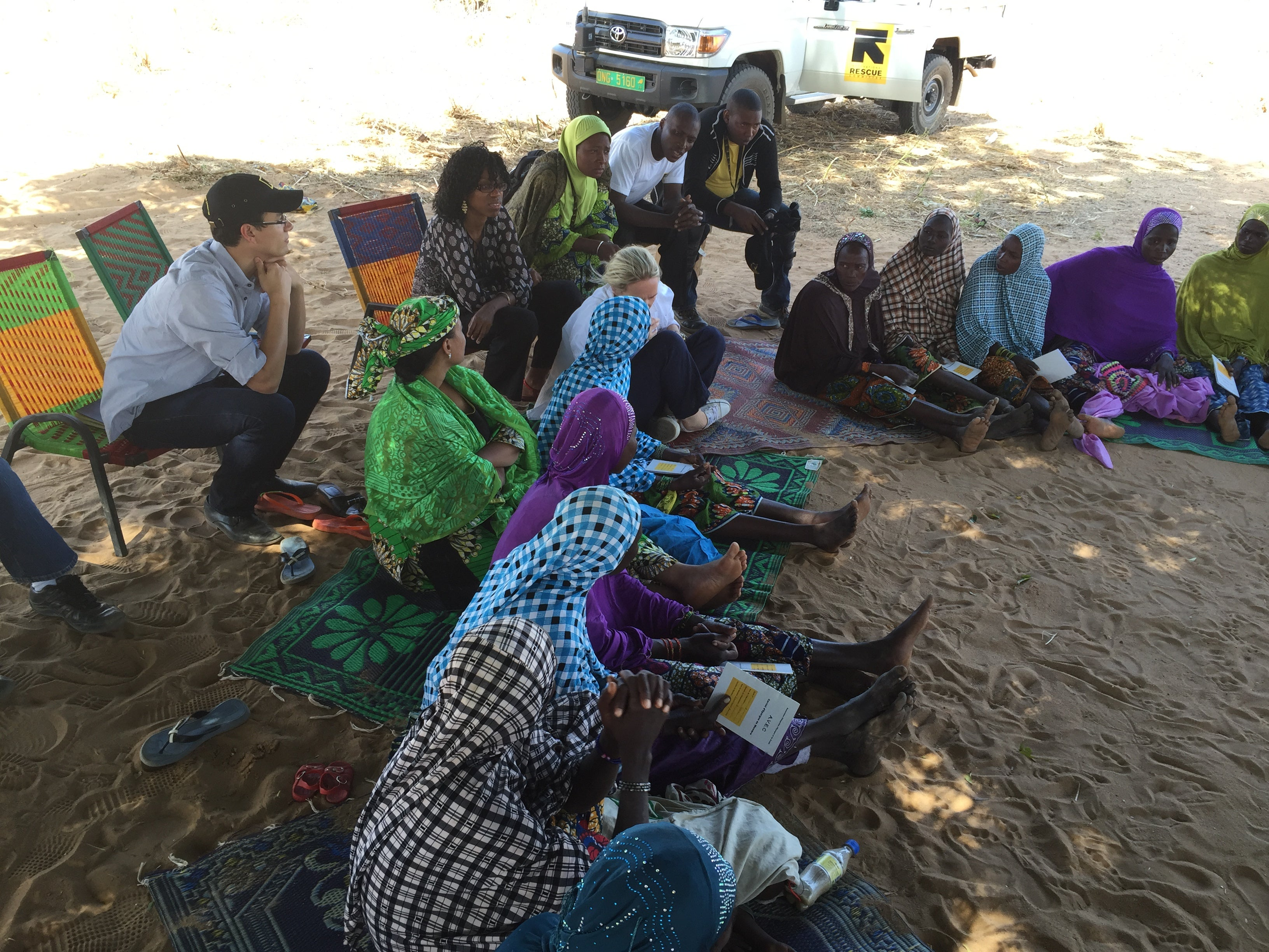 Ben Wise in a high poverty area of Niger attending a women's microfinance group's weekly deposit meeting organized by IRC
