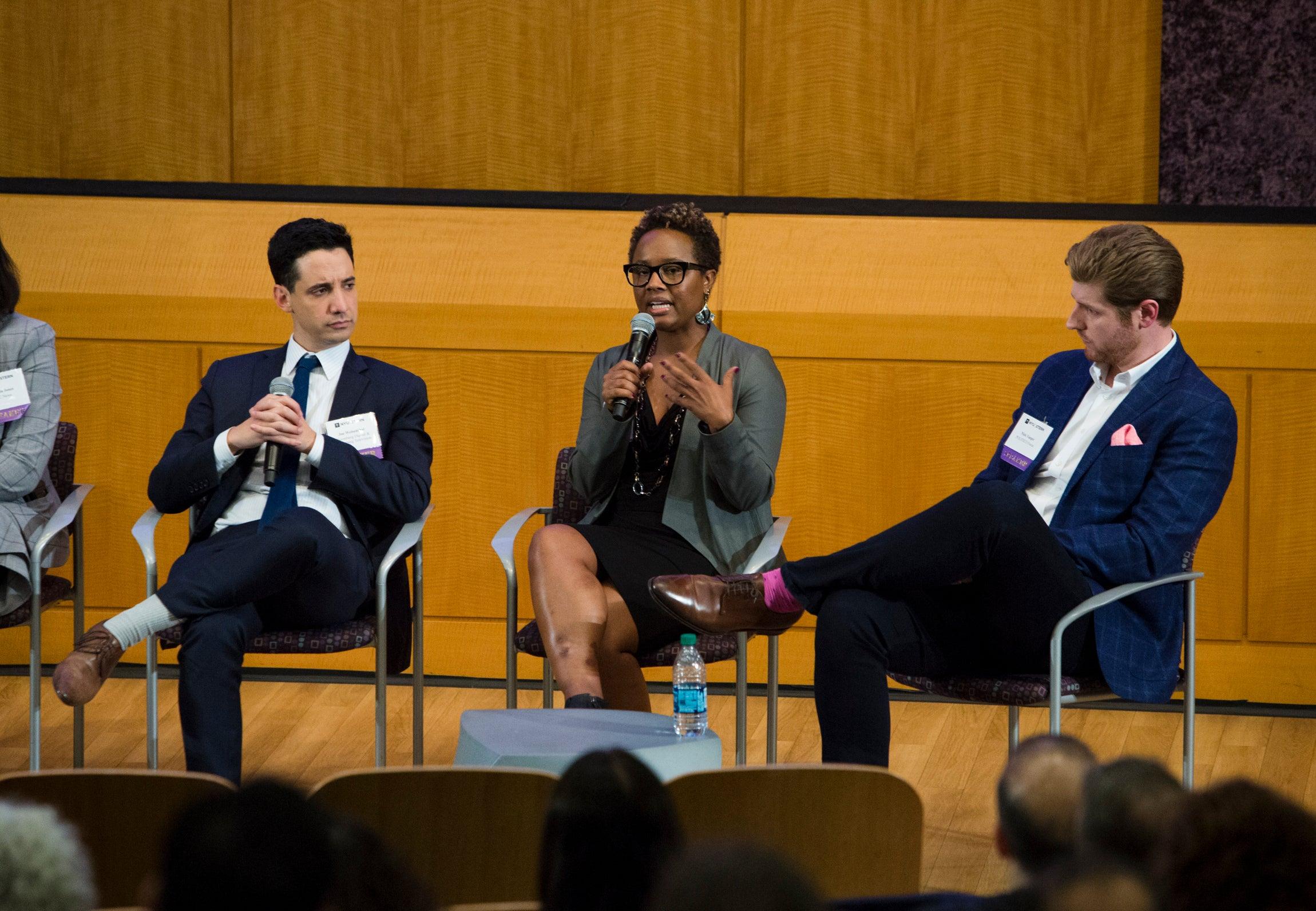 Panelists speak during the EMT Summit 2018