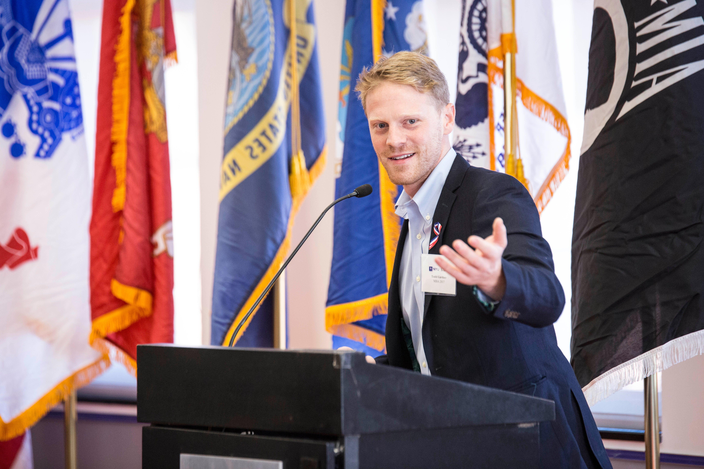 Military veterans alumnus addresses the room