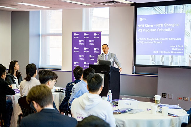 Assistant Dean of Graduate & Advanced Education at NYU Shanghai Eric Mao greets the inaugural one-year master's programs cohorts