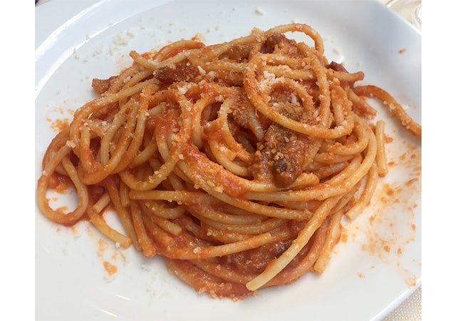 A close-up of a dish of amatriciana pasta served in Rome, Italy.