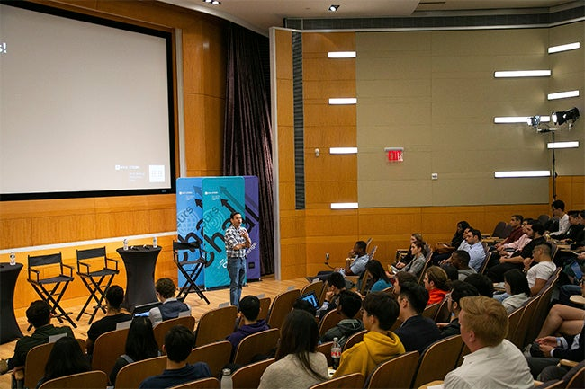 Professor Deepak Hegde addresses the crowd