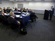 Joshua Ronen speaks to roundtable attendees
