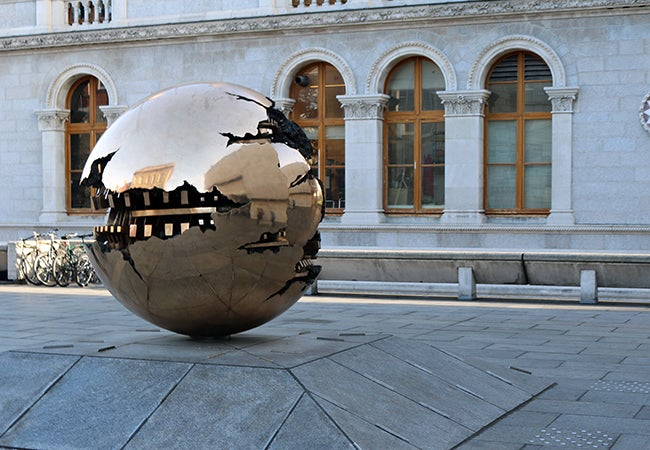 A bronze sculpture spherical in shape titled Sfera con Sfera (or sphere within a sphere) in Ireland.