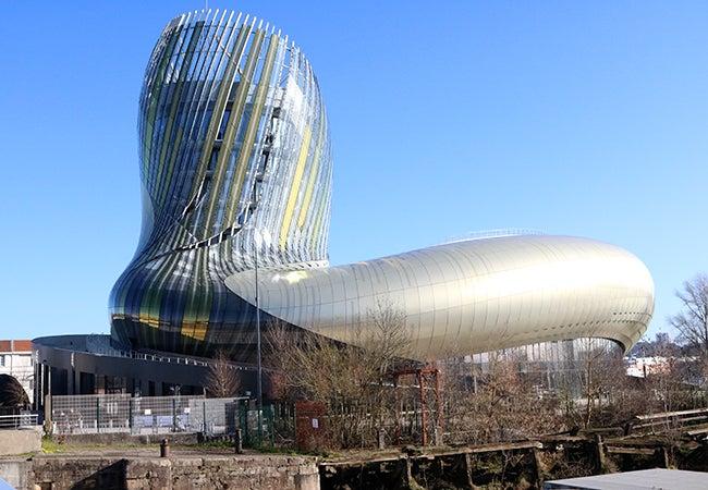 The abstract exterior design of La Cité du Vin, the world's largest wine museum.