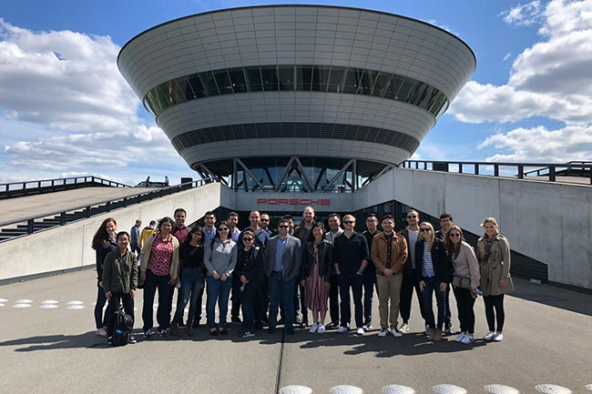 MBA Students pose for a photo outside the Porsche factory in Leipzig, Germany.