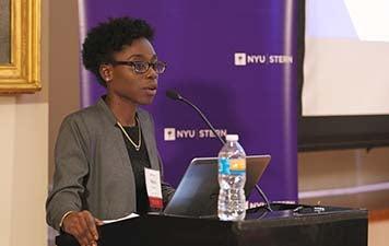 Nana Apraku speaks at a podium