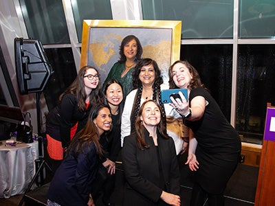 Dean Menon and dean's office team take a selfie with the portrait