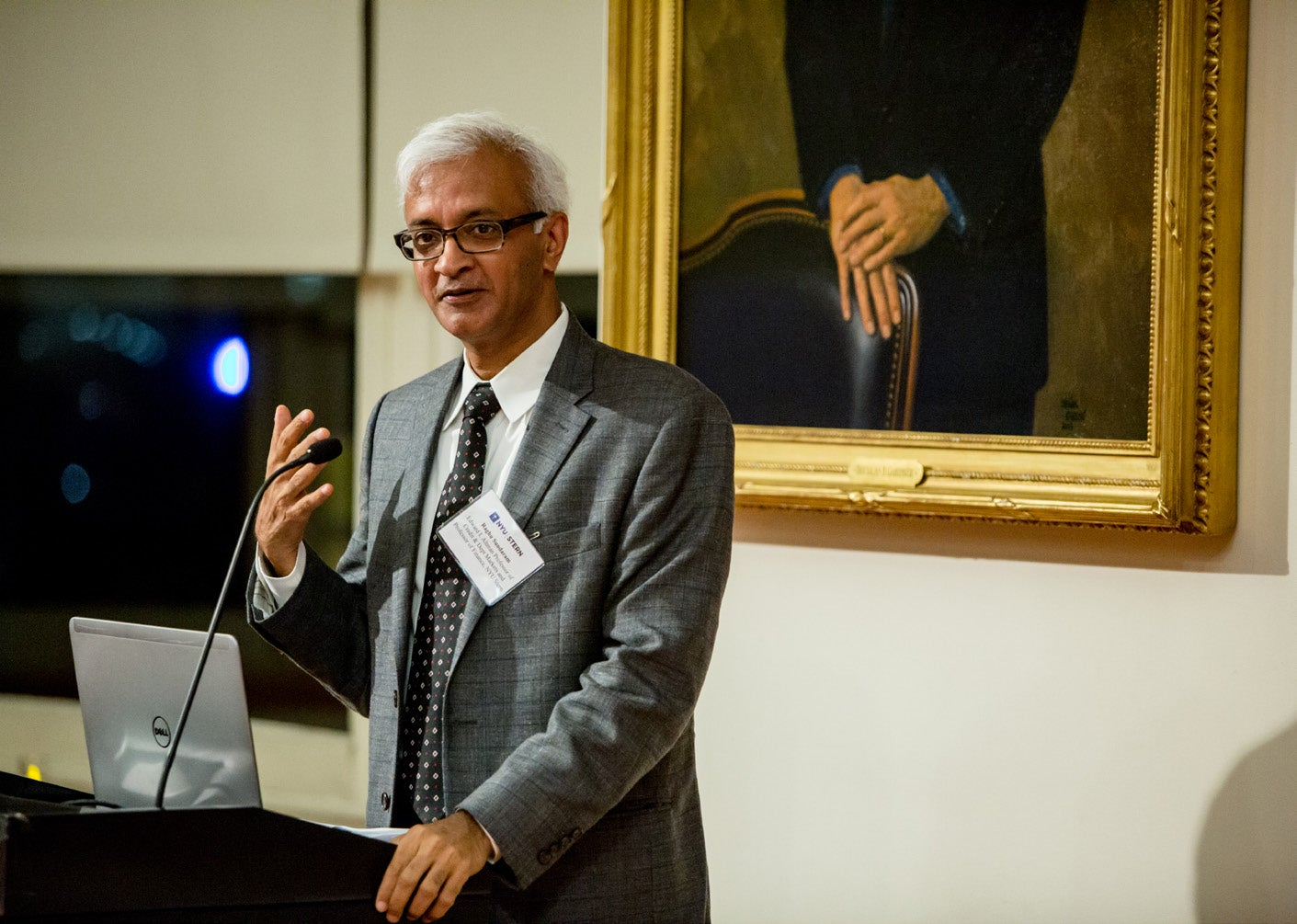 Photo of Dean Sundaram speaking at a podium