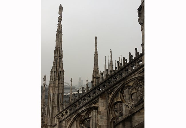 A view looking out over ornate stonework from the Duomo in Milan, the highest point in the cathedral.