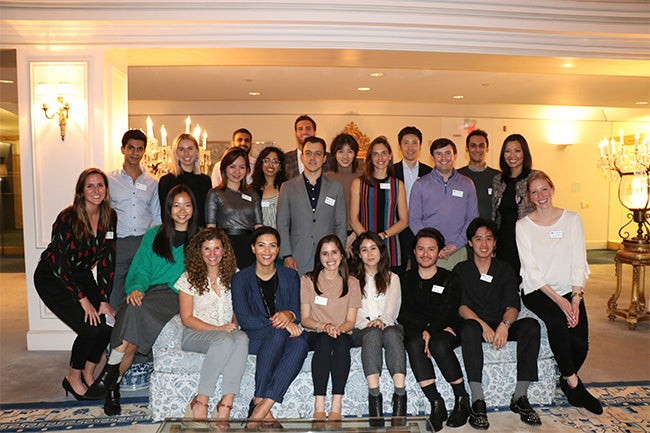 Fashion & Luxury MBA students pose at the Fashion & Luxury MBA Welcome Reception hosted at Estée Lauder Corporate Headquarters.