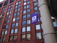 NYU Stern Tisch building with NYU flag
