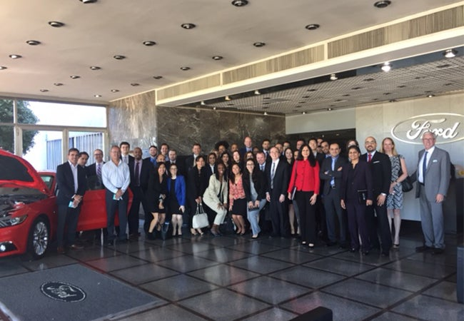 Executive MBA students tour a Ford facility in Buenos Aires during a class trip.