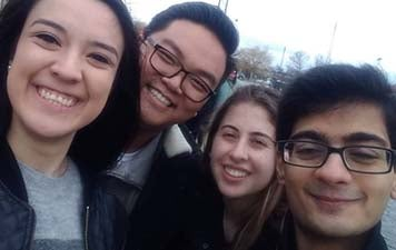 Nicole and three friends smile for a selfie