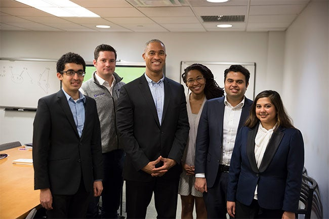 Dean Emeritus and Professor Peter Henry (Center) with (from left to right) Vikram Gulati (MBA '19), Sean Quinn (MBA '19), Nashilu Mouen-Makoua (MBA '18), Mohnish Zaveri (MBA '18) and Anila Mahadeo (MBA '18)