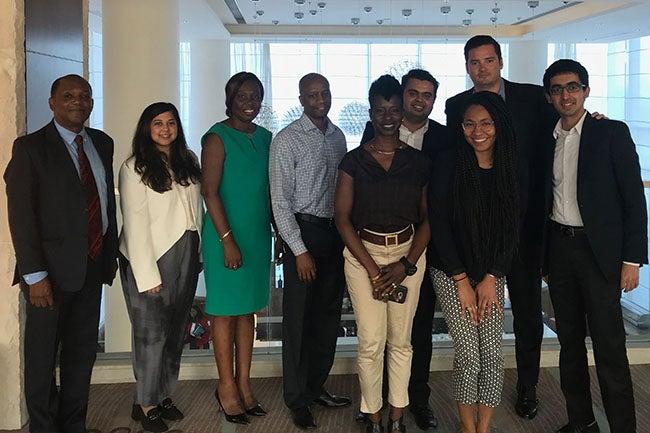 NYU Stern MBA students and alumni onsite in Guyana: Eric Phillips (MBA '83); Anila Mahadeo (MBA '18); Alisson Butters-Grant, CEO & President, Global Seafood Distributors, Inc; Selwin George (BS '93); Oslene Carrington (MBA '95); Mohnish Zaveri (MBA '18); Nashilu Mouen-Makoua (MBA '18); Sean Quinn (MBA '19); Vikram Gulati (MBA '19)