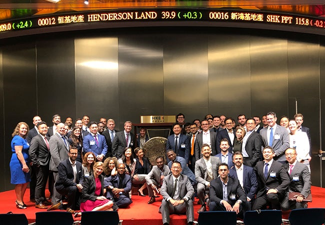 MBA students gather for a group photo at the Hong Kong stock exchange.