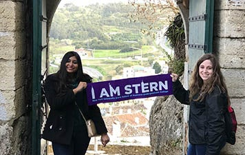 "Jacqueline Finn and Tasnuva Tumim hold a ""I am Stern"" banner in Lisbon"