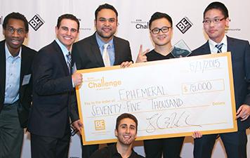Josh Sakhai and teammates holding check for $75,000