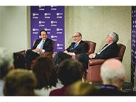 From left to right: John A. Paulson, Dr. Alan Greenspan and Lord Mervyn King