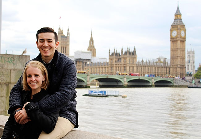 Undergraduate student Michelle Enkerlin leans into the arms of her boyfriend with the River Thames in the background.