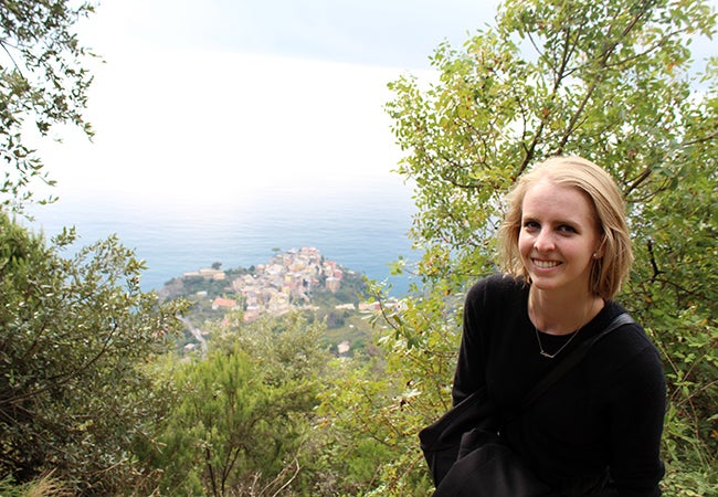 Undergraduate student Michelle Enkerlin pauses for a photo at a spot that overlooks a village in Cinque Terre, Italy.