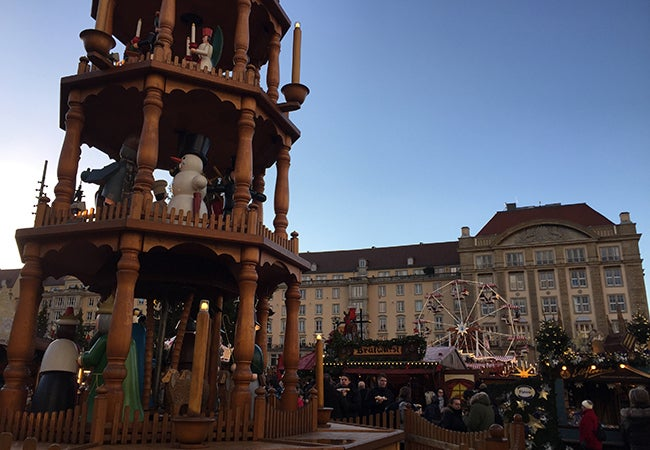 A carousel of snowmen and other seasonal characters stands at the center of the Dresden Christmas market.