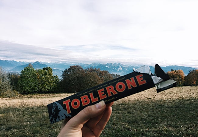 Toblerone candy bar in front of mountains