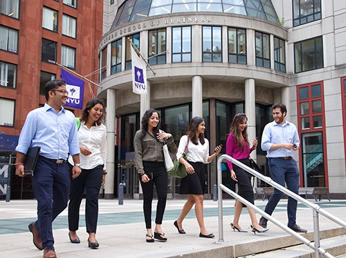 Members of the Stern community walking on Gould Plaza at Stern