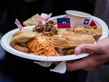 Plate holding food from different countries
