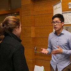 Student speaking with professional
