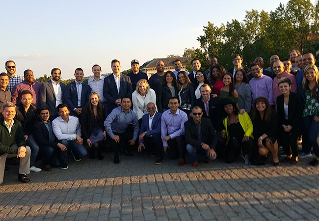 Executive MBA students pose for a photo outside during their visit to Prague.