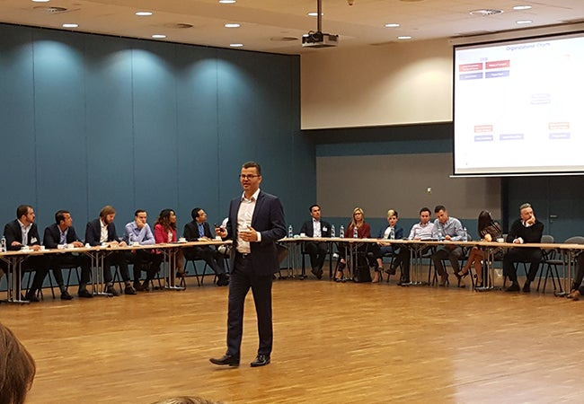 A speaker presents to a room of students during their MBA trip in Prague.