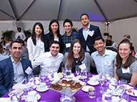 A group of Stern Alumni pose at a Reunion 2018 event