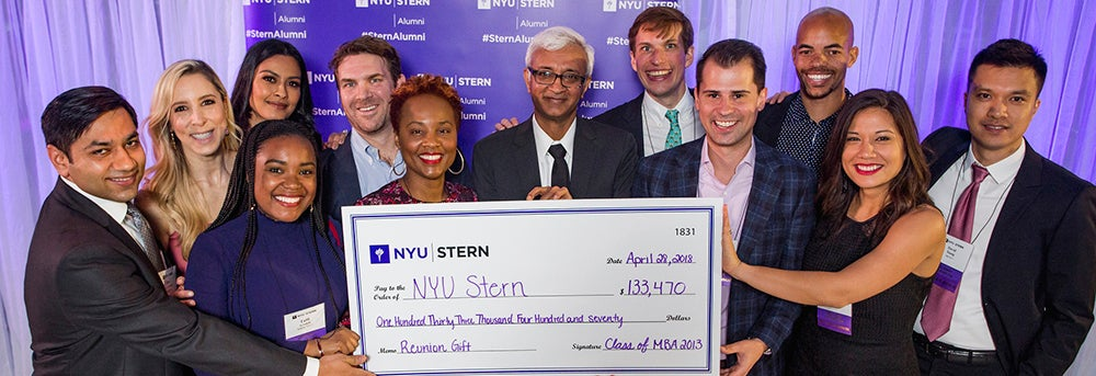 Stern alumni present Dean Sundaram with a check in honor of their Reunion