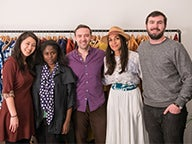 A group of NYU Stern MBA students stand with Stern alumna Abrima Erwiah (BS '02) and actress Rosario Dawson, co-founders of Studio One Eighty Nine