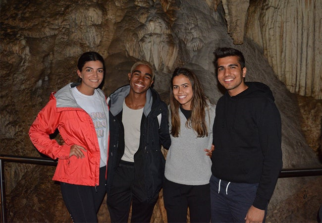Undergraduate business student Dimitri Pun poses with three friends while studying abroad in Sydney, Australia.