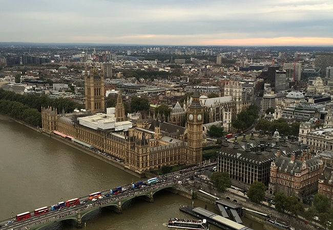 An aerial view of London shows Big Ben and the River Thames.