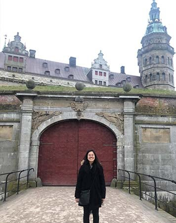 Yang Fu stands in front of Kronborg Castle
