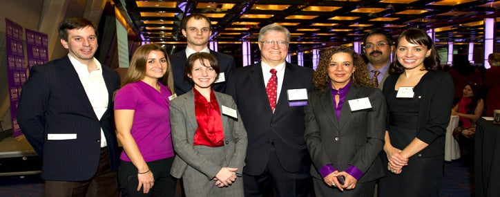Stern scholarship recipients pose with donors at a Stern sponsored event.