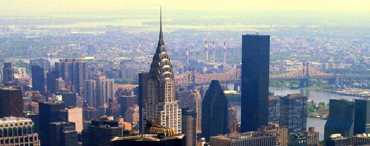 Photo of NYC skyline featuring the Brooklyn Bridge.