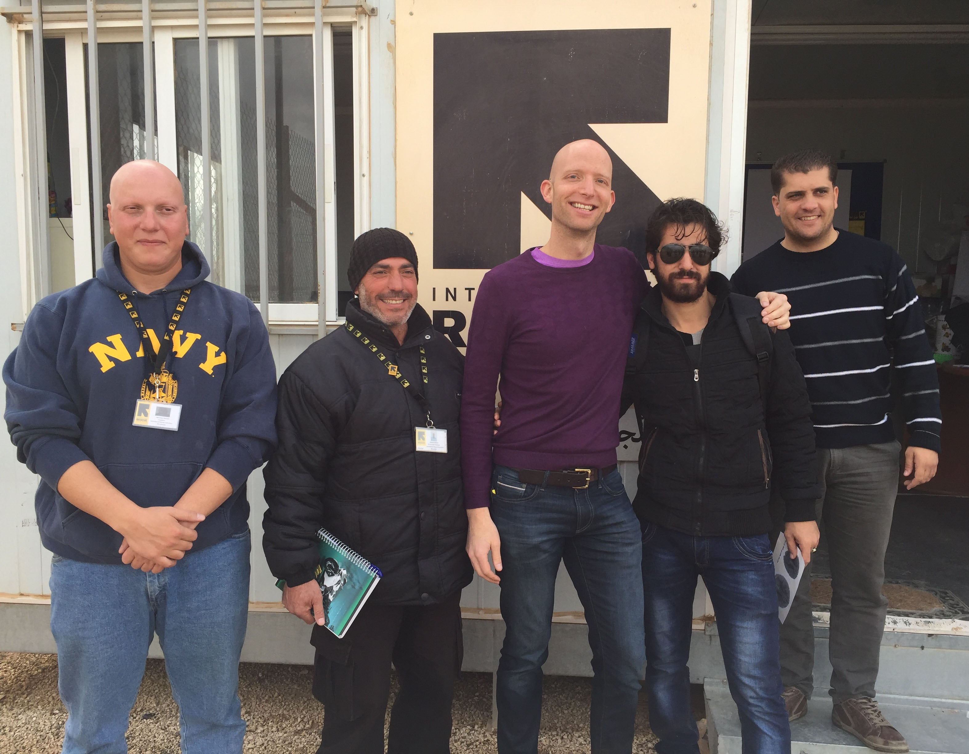 Austin Riggs with Jordanians and Syrians in Azraq refugee camp in Eastern Jordan