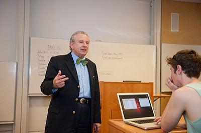 Professor Al Lieberman teaching to classroom of students