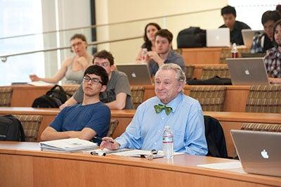 Professor Al Lieberman sitting in a classroom of BEMT students