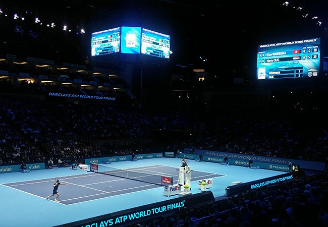 Tennis players Stan Wawrinka and Marin Cilic compete in an indoor stadium at the 2016 ATP World Tour Finals.