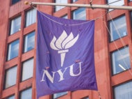 NYU flag hangs outside of Tisch Hall.
