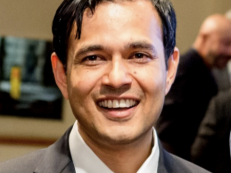 A headshot of Academic Director, Deepak Hegde, smiling at the camera.