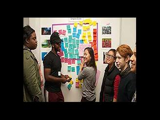 A group of student talking about their ideas