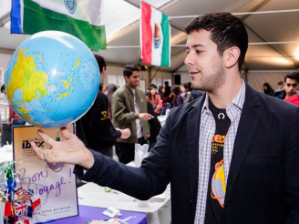 Student holding up globe at Passport Day