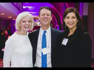 From right to left: Christine Schneider (MBA '94), Todd Spillane, and Susan Jurevics (MBA '96) at a Stern Holiday Celebration.